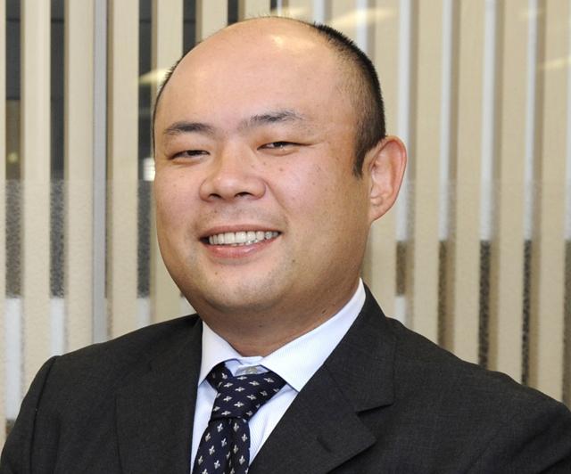 AFP Chairman Emmanuel Hoog (L) shakes ha
